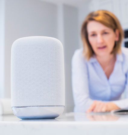 Woman asking Google Home for health care advice
